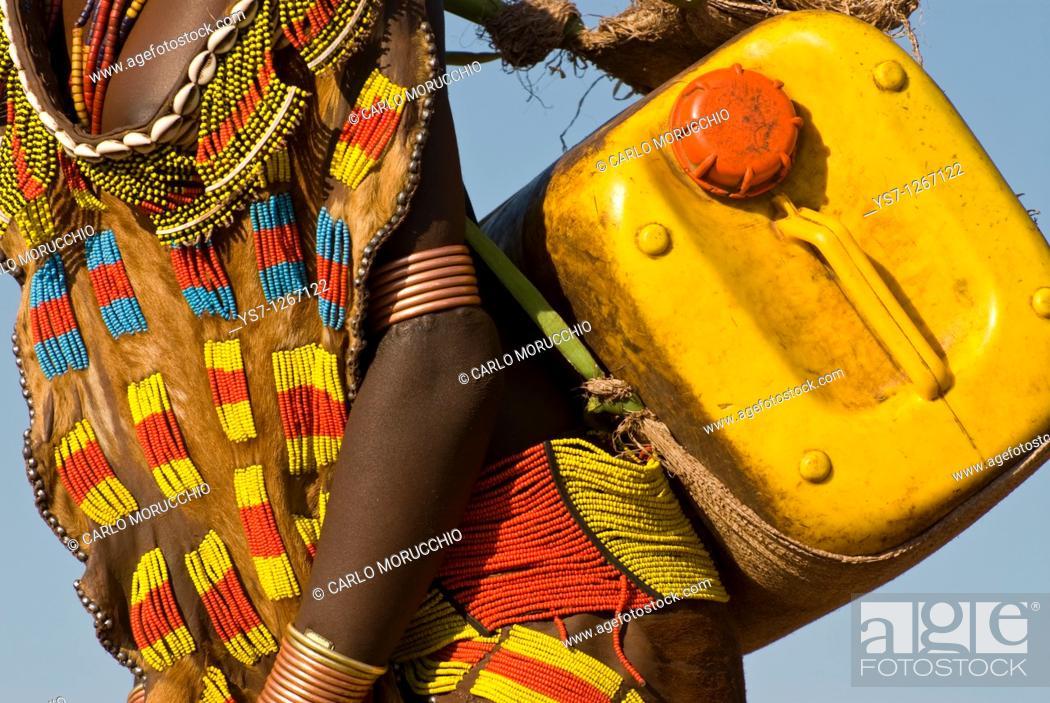 Stock Photo: Hamer girl carrying water can, Turmi, Omo region, Ethiopia.
