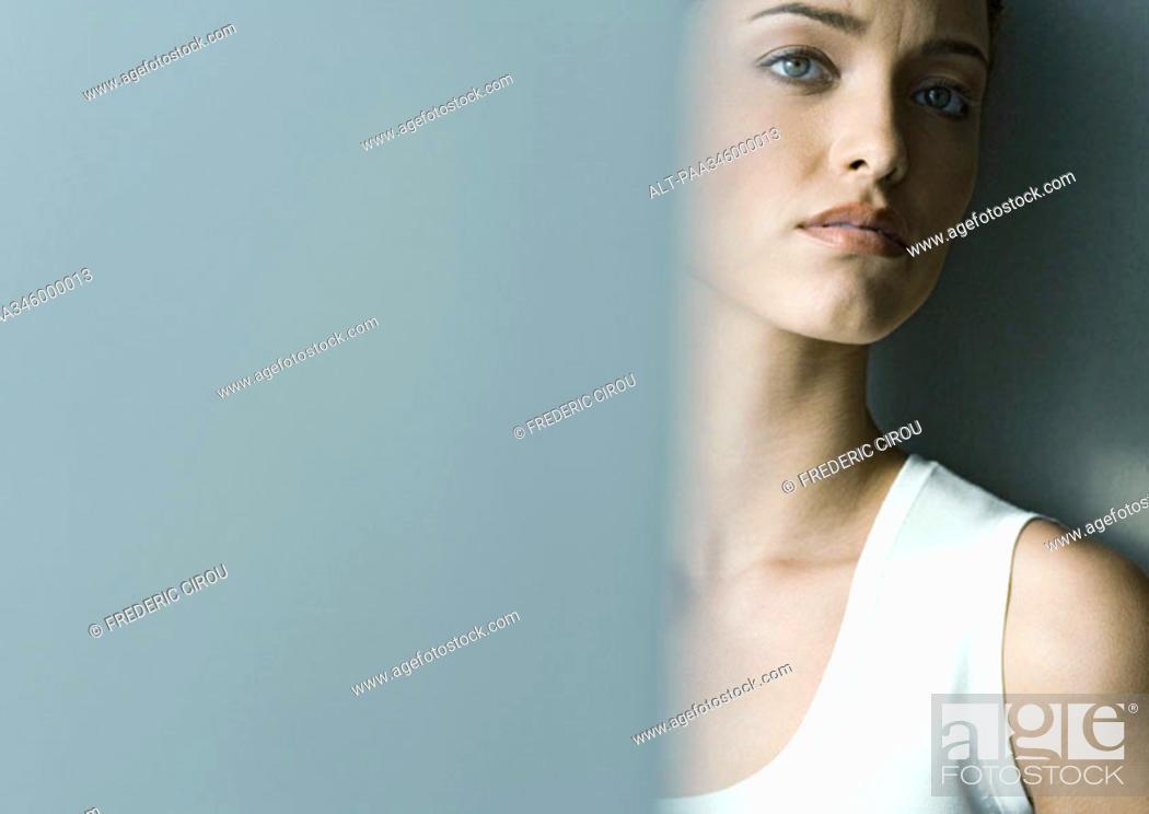 Stock Photo: Woman furrowing brow.