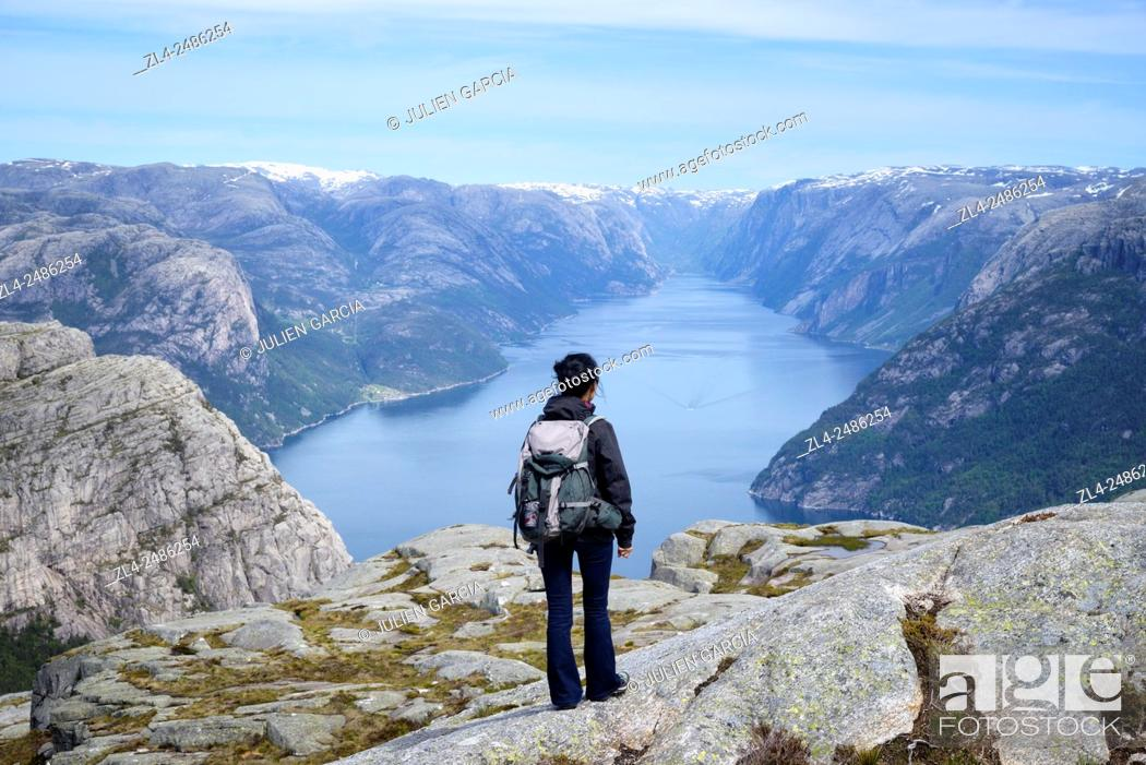 Stock Photo: Norway, Rogaland, Lysefjord, hiker on the trail to Preikestolen (Pulpit Rock) 600m above the fjord, Model Released.
