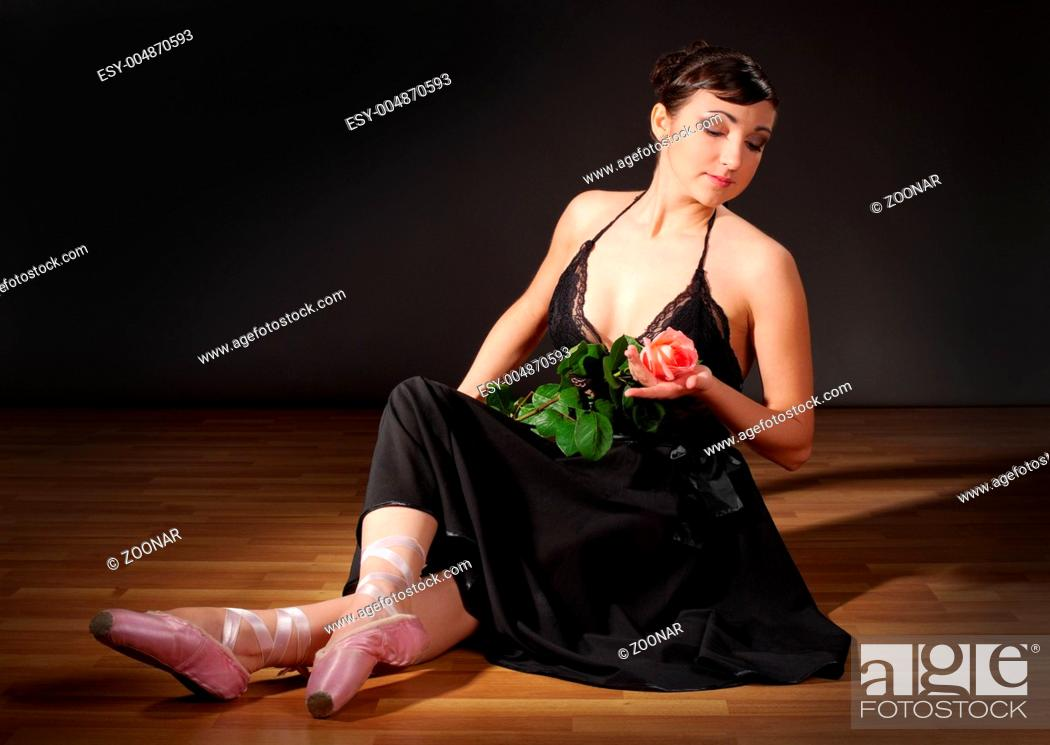 Stock Photo: Young ballerina sit on the floor.