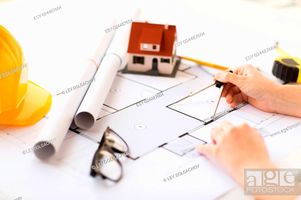 Stock Photo: business, architecture, building, construction and people concept - close up of architect hands with compass measuring living house blueprint.