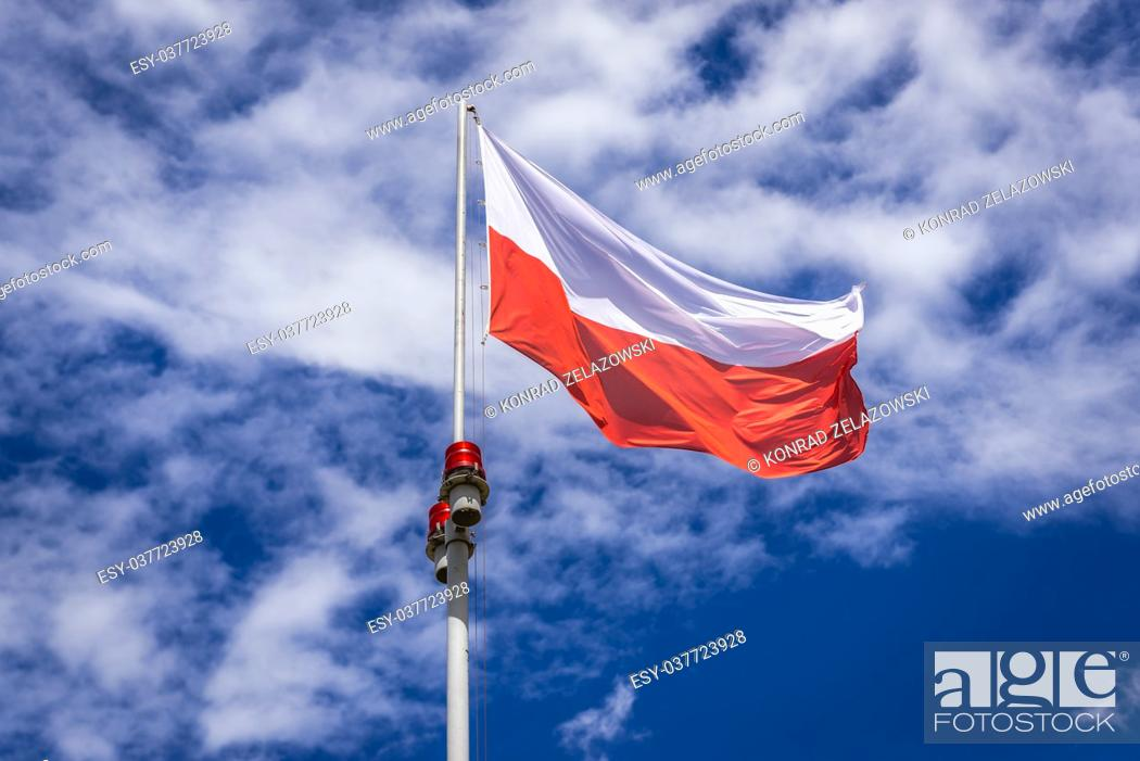 Stock Photo: Polish flag on Pilsudski Mound also called Independence Mound on the Sowiniec Heights in Cracow city, Lesser Poland Voivodeship of Poland.
