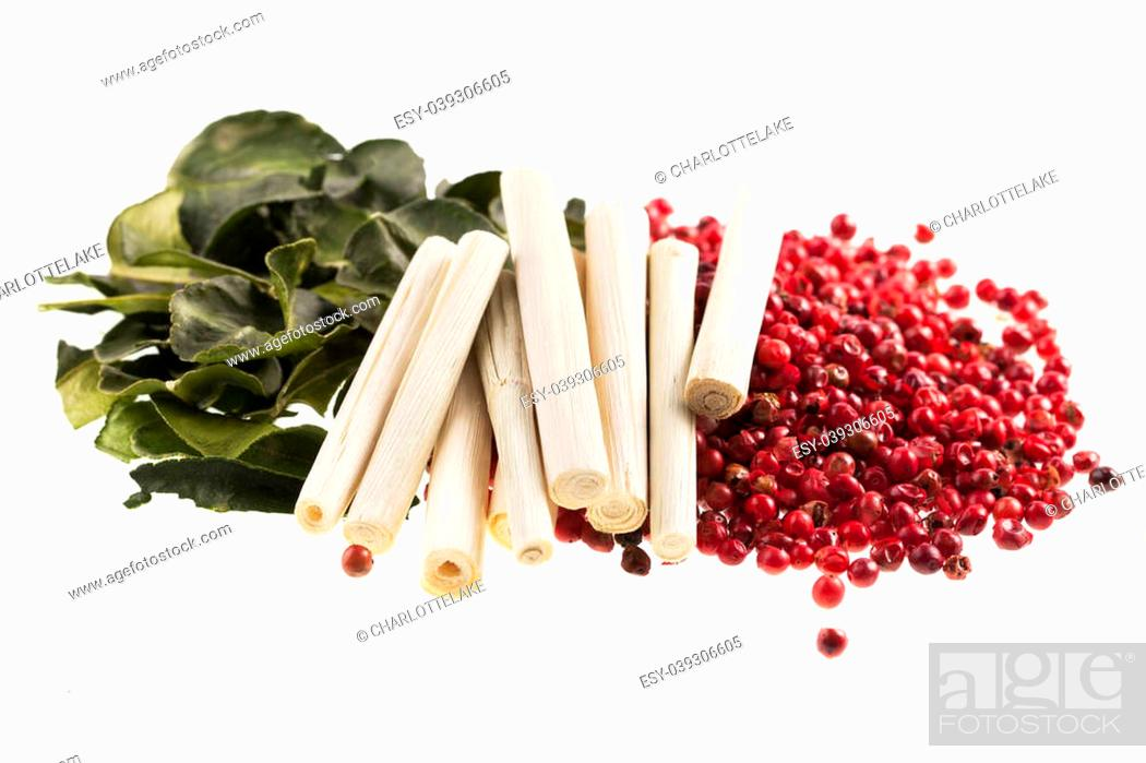 Stock Photo: Thai cooking spices, kaffir lime leaves, lemon grass and pink peppercorns isolated on a white background.