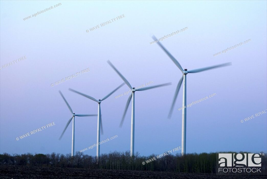Stock Photo: Row of wind turbines.