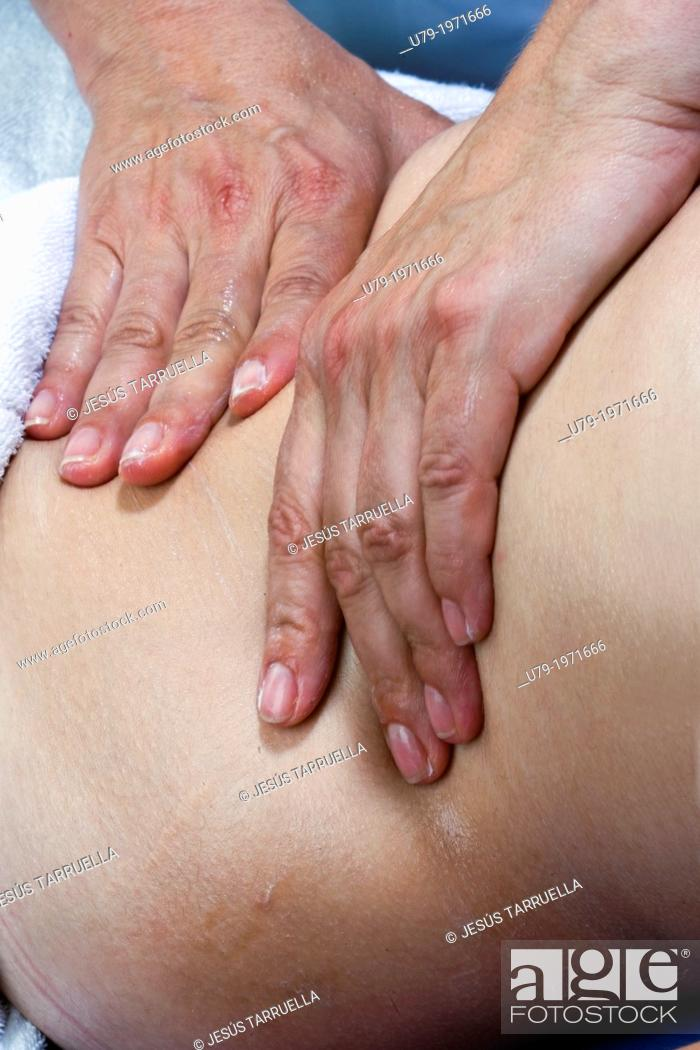 Stock Photo: Women in abdominal massage therapy.