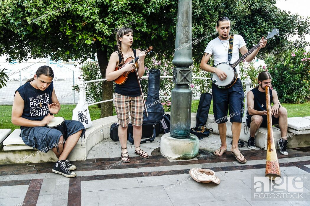Stock Photo: Group of buskers by the park in Opatija, Croatia.