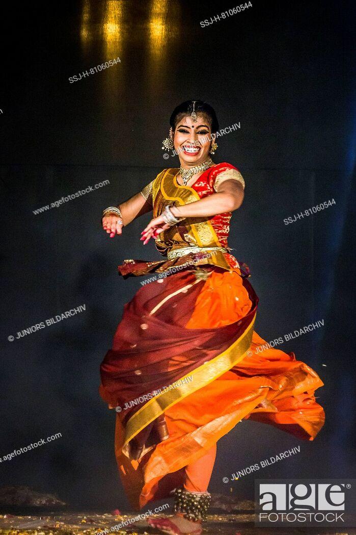 Stock Photo: Dancer at Holika Dahan celebration. Udaipur, Rajasthan, India.