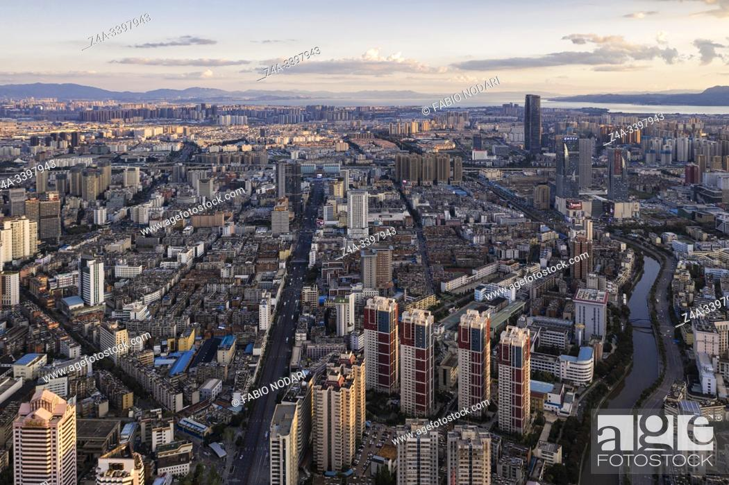 Stock Photo: Kunming, China. Aerial view of Kunming at sunset with the Dianchi lake on background.