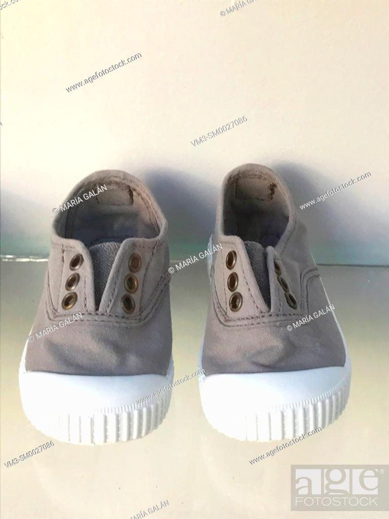 Photo de stock: Pair of children sneakers.