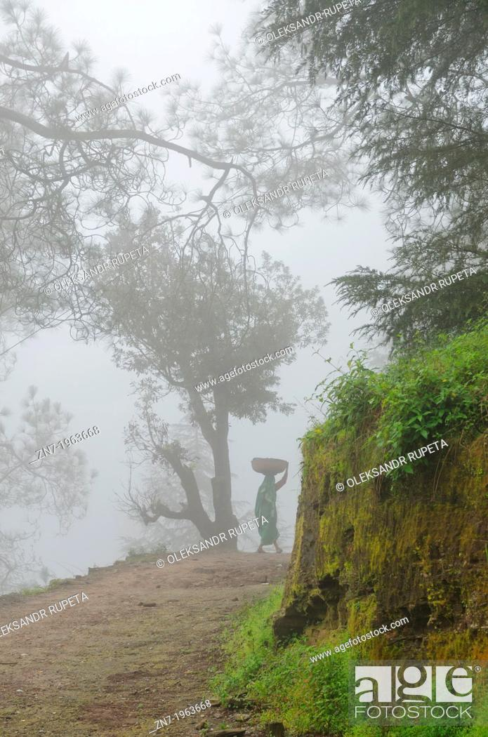 Stock Photo: A woman on mountain road, Himalayan range, Almora, India.