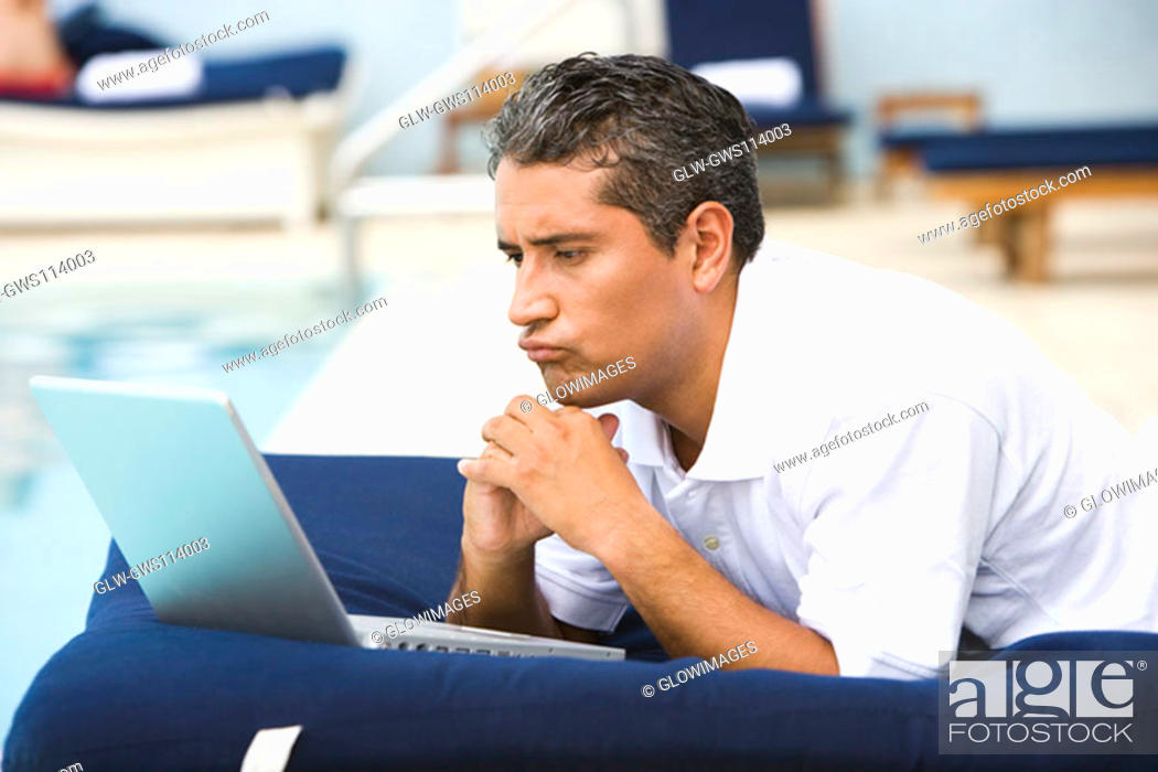 Stock Photo: Close-up of a mid adult man using a laptop.