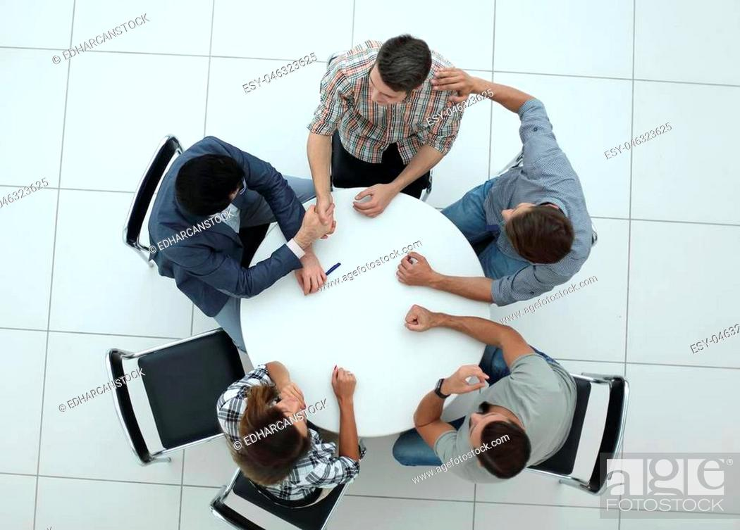 Photo de stock: top view.creative business group sitting at the round table.photo with copy space.