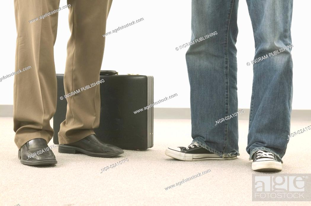 Stock Photo: Legs in front of briefcase.