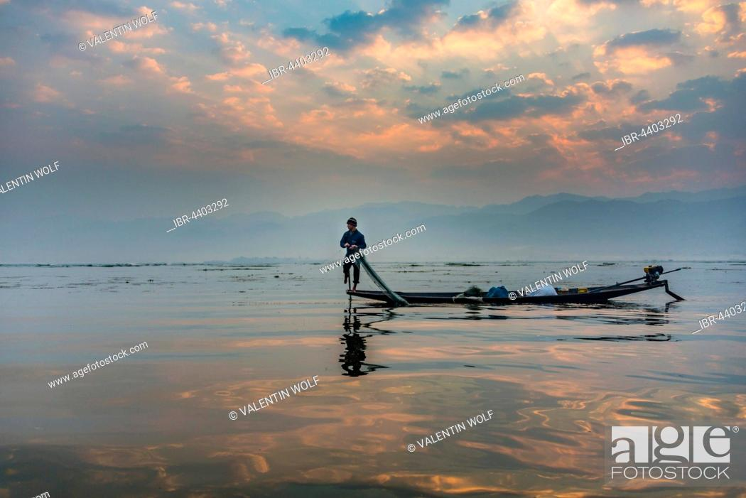Stock Photo: Local Intha fisherman rowing boat with one leg, unique local practice, sunrise, dawn, Inle Lake, Shan State, Myanmar.