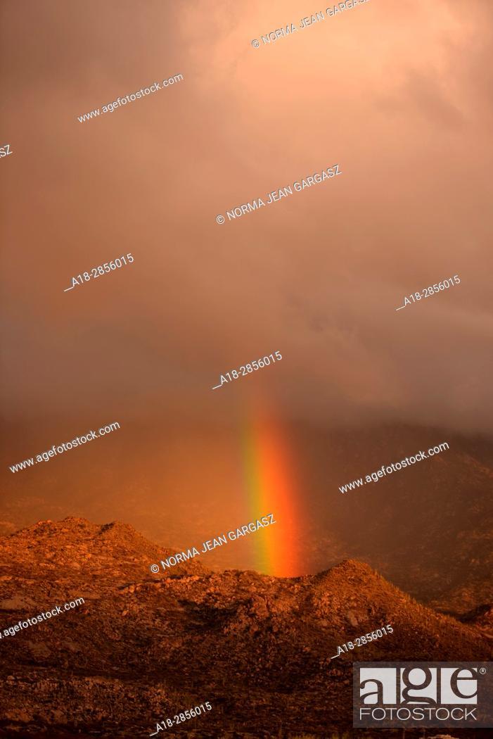 Stock Photo: A rainbow develops over the Santa Catalina Mountains, Sonoran Desert, Coronado National Forest, Oro Valley, Arizona, USA.