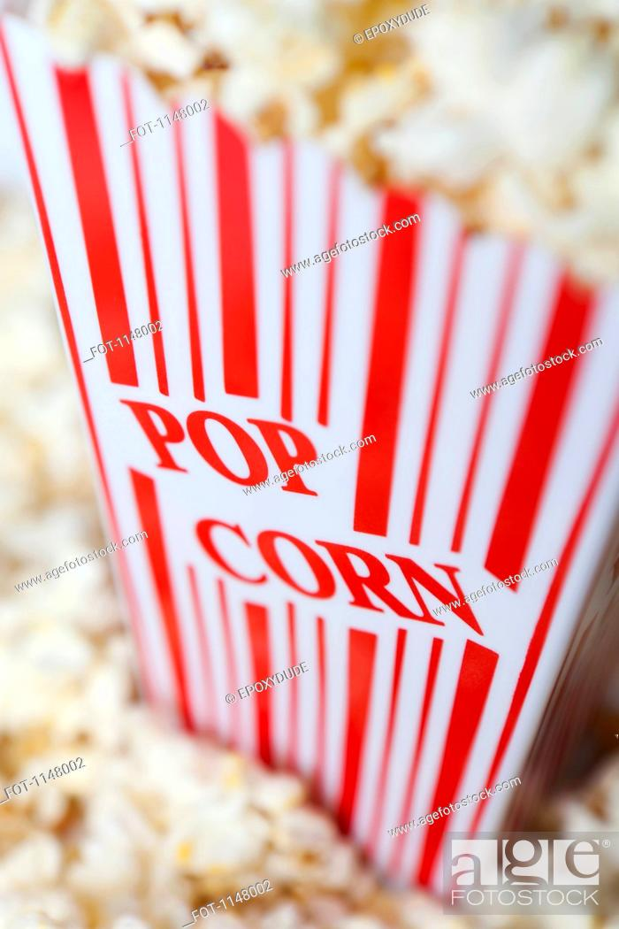 Stock Photo: Detail of a red striped popcorn carton with Popcorn printed on it.