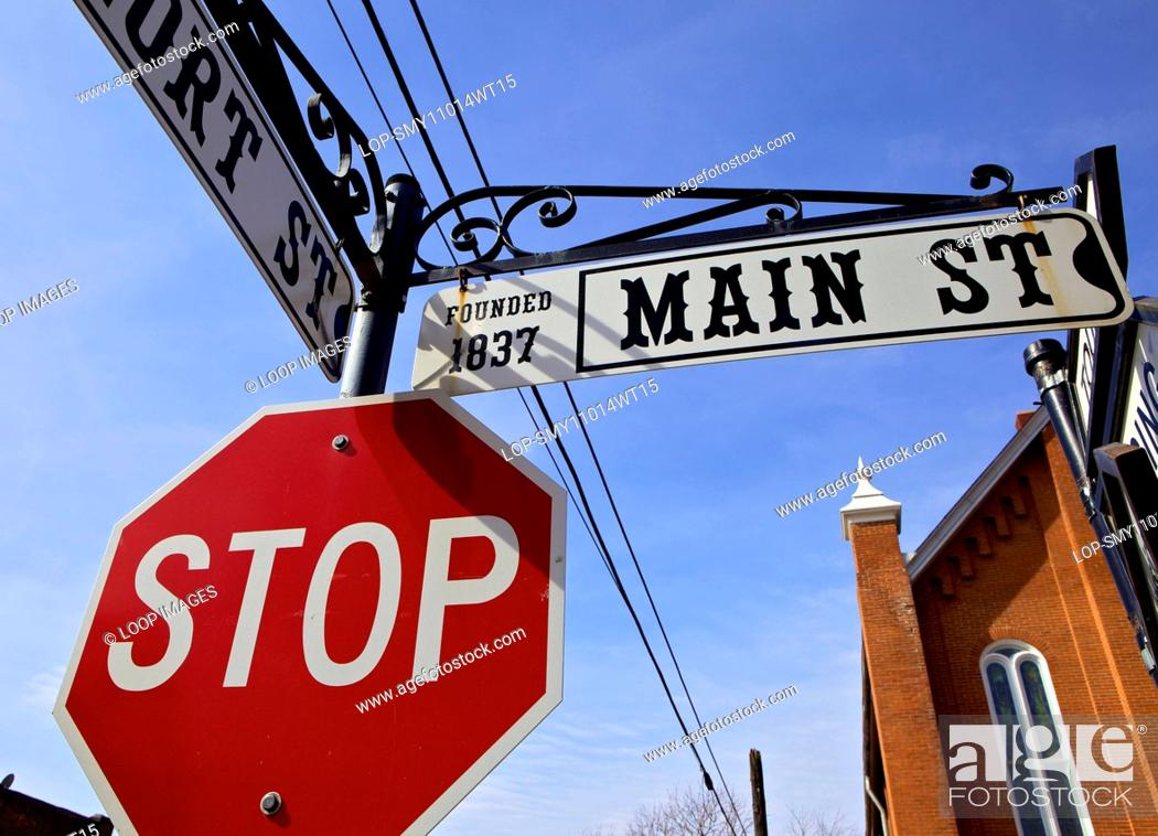 Stock Photo: Street signs on Main Street in the historic town of Weston in Missouri.