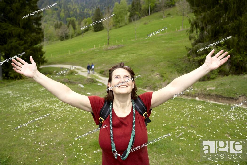 Stock Photo: Happy mature woman in countryside. Bad Tölz, Upper bavaria, Germany.