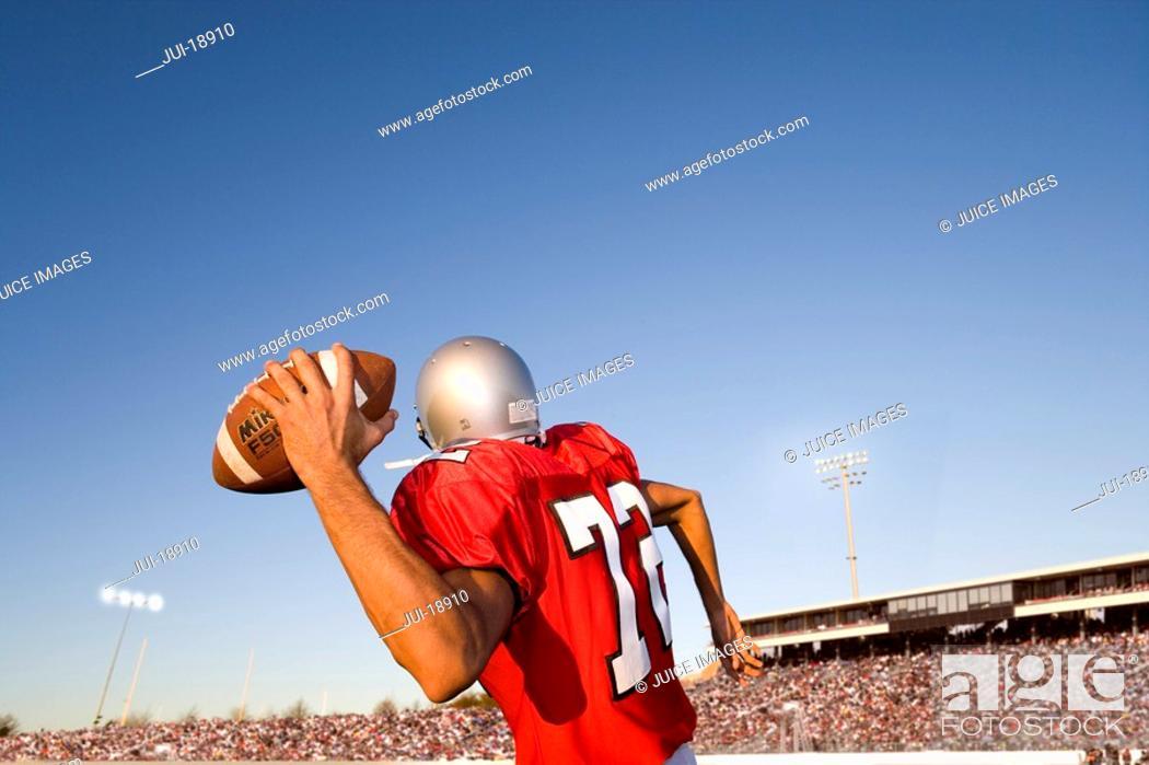 Stock Photo: Quarterback throwing football.