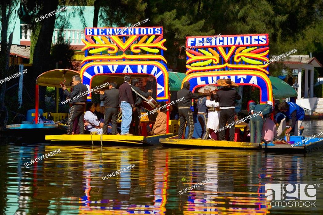 Stock Photo: Tourists on trajineras boats in a canal, Xochimilco Gardens, Mexico City, Mexico.