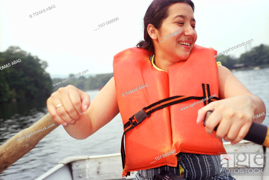 Stock Photo: Latino woman rowing boat.