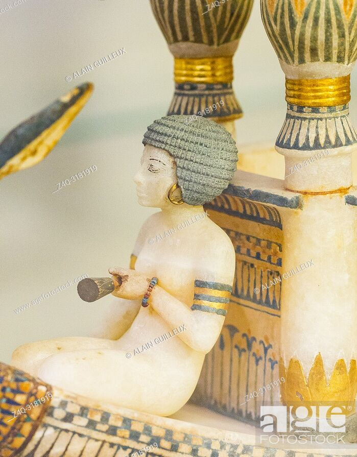 Stock Photo: Egypt, Cairo, Egyptian Museum, Tutankhamon alabaster, from his tomb in Luxor : Detail of a boat, woman sitting in front of a kiosk. She holds a lotus.