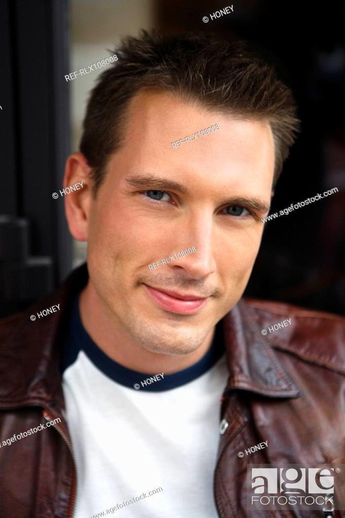 Stock Photo: Portrait of young man wearing leather jacket, Paris, France.