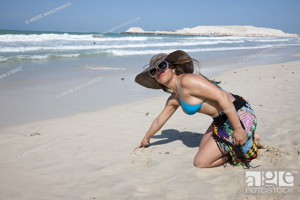 Stock Photo: Woman on Jumeirah beach in Dubai. Model release.