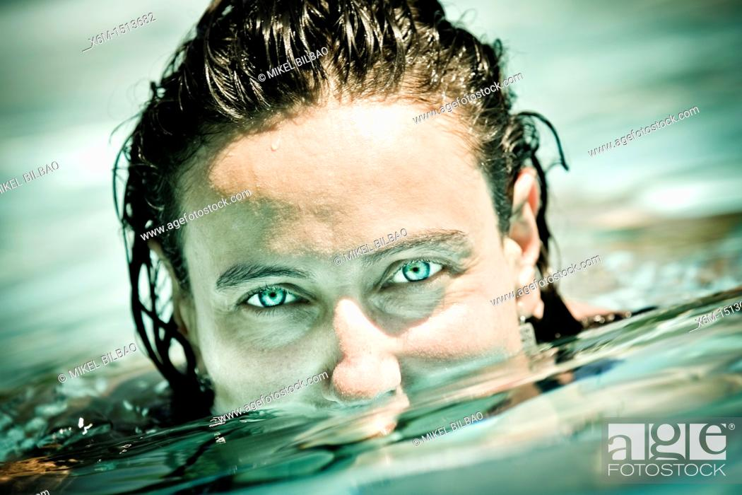 Stock Photo: Young woman portrait on a swimming pool.
