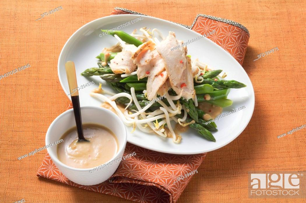 Stock Photo: Green asparagus with orange sauce.