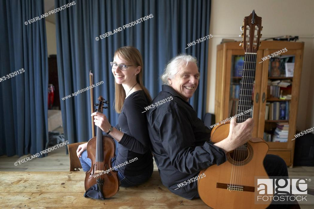 Stock Photo: musical duo, ready to play duet with violin and guitar.