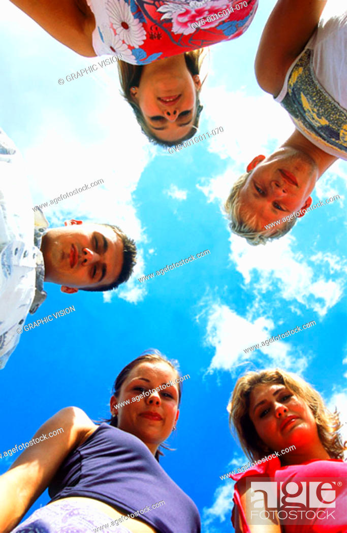 Stock Photo: Portrait of a group of young people standing looking down.