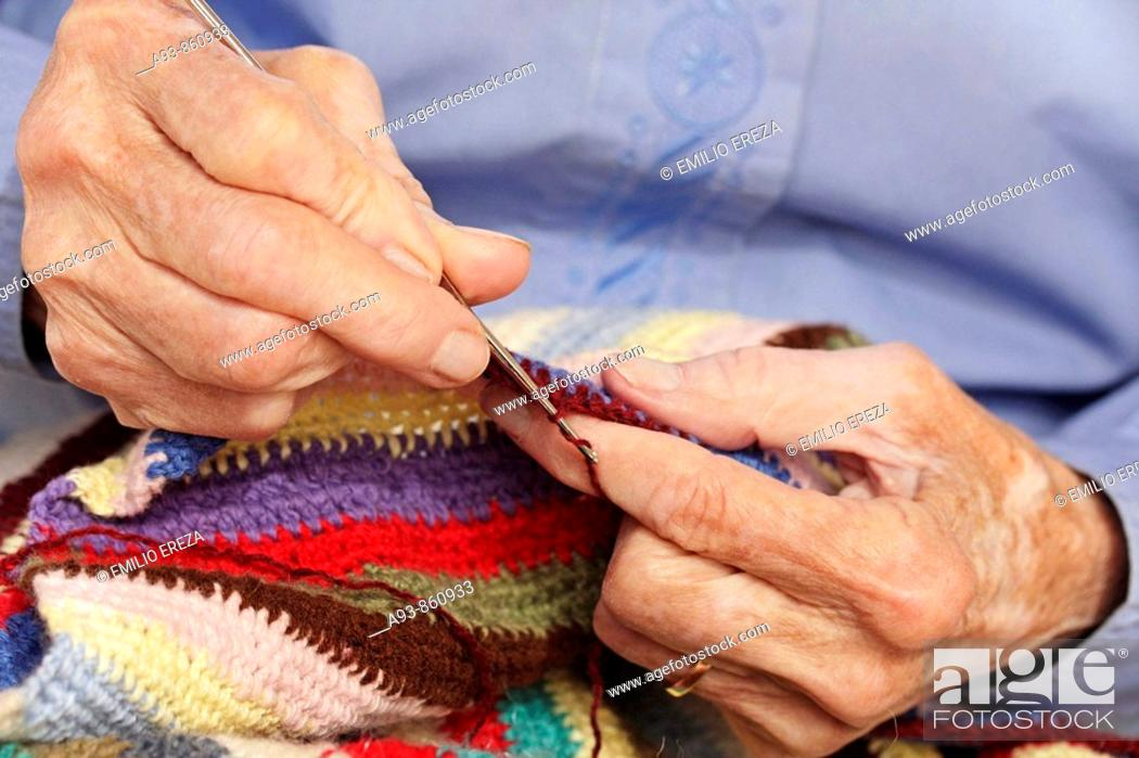 Stock Photo: Old woman crocheting.