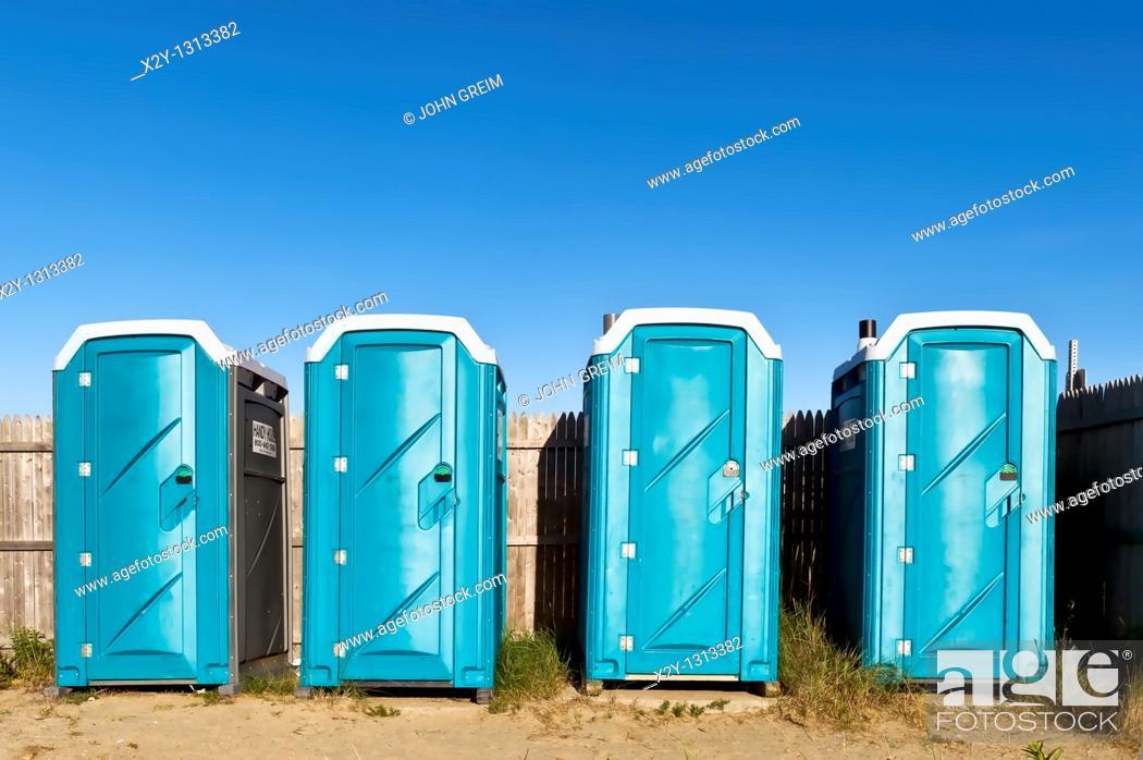 Stock Photo: Portable toilets at the beach.