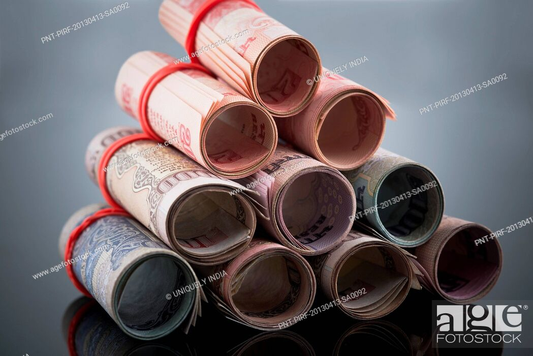 Stock Photo: Close-up of rolled-up Indian paper currency.