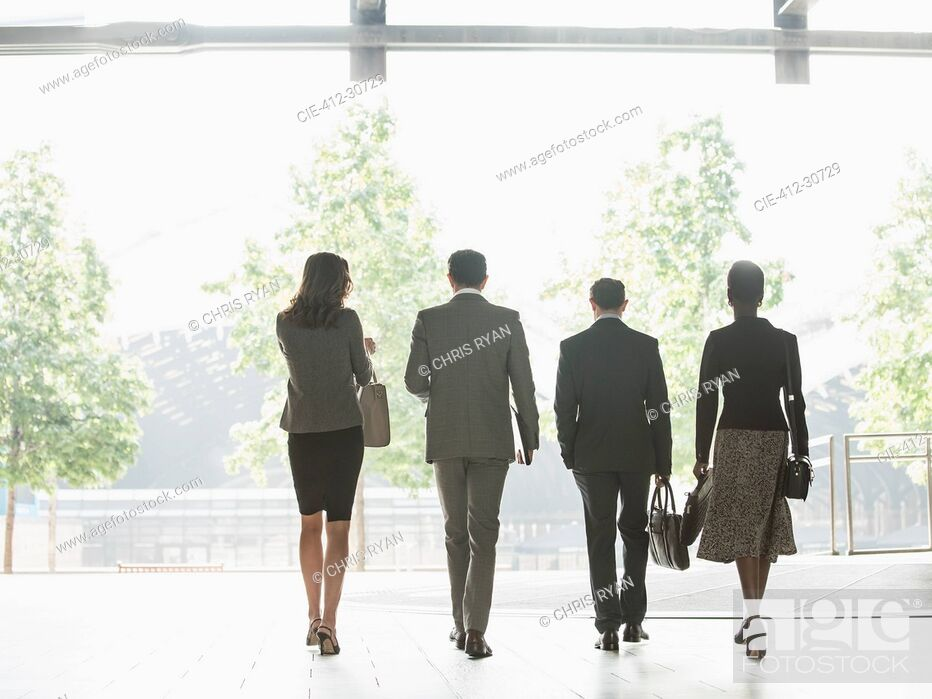 Photo de stock: Corporate business people walking in a row.