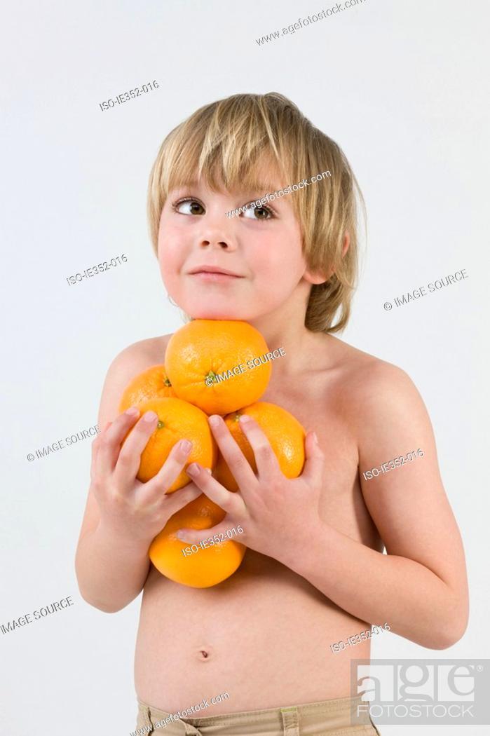 Stock Photo: Boy holding oranges.