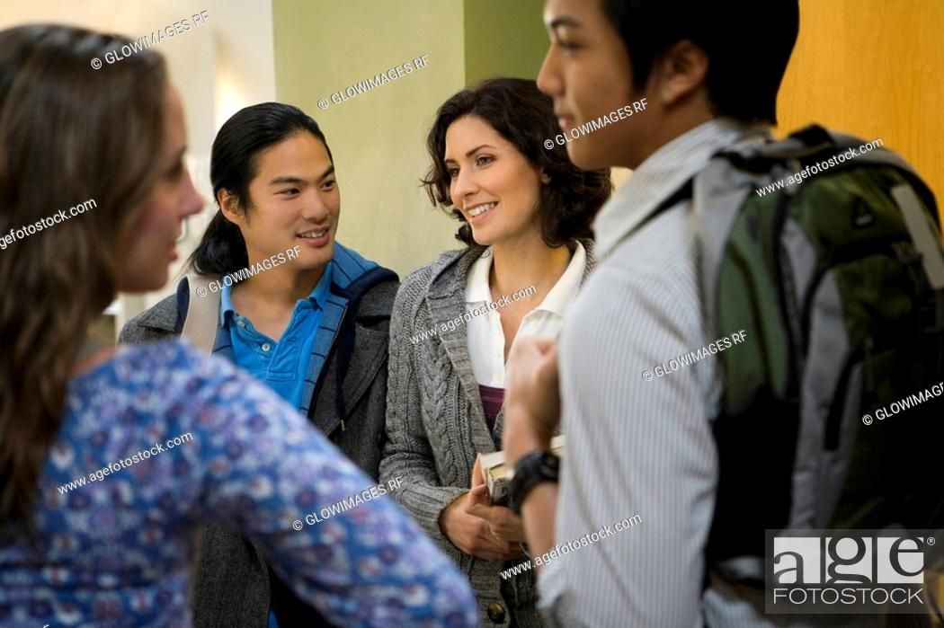 Stock Photo: University students talking in a corridor.