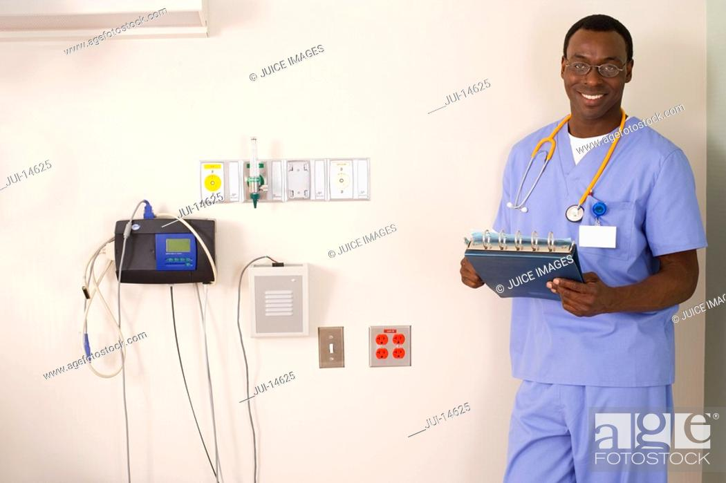 Stock Photo: Doctor with folder and stethoscope, smiling, portrait.