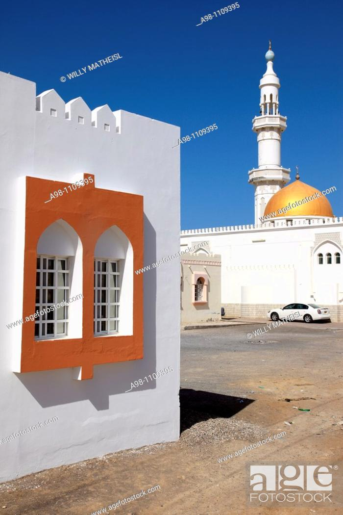 Stock Photo: facade of a house with window and mosque with minaret in the village of Sur, Ash Sharqiyah Region, Sultanate of Oman, Asia.