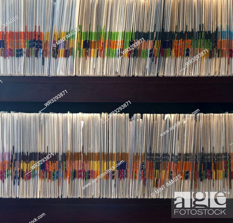 Stock Photo: Files arranged in shelves.