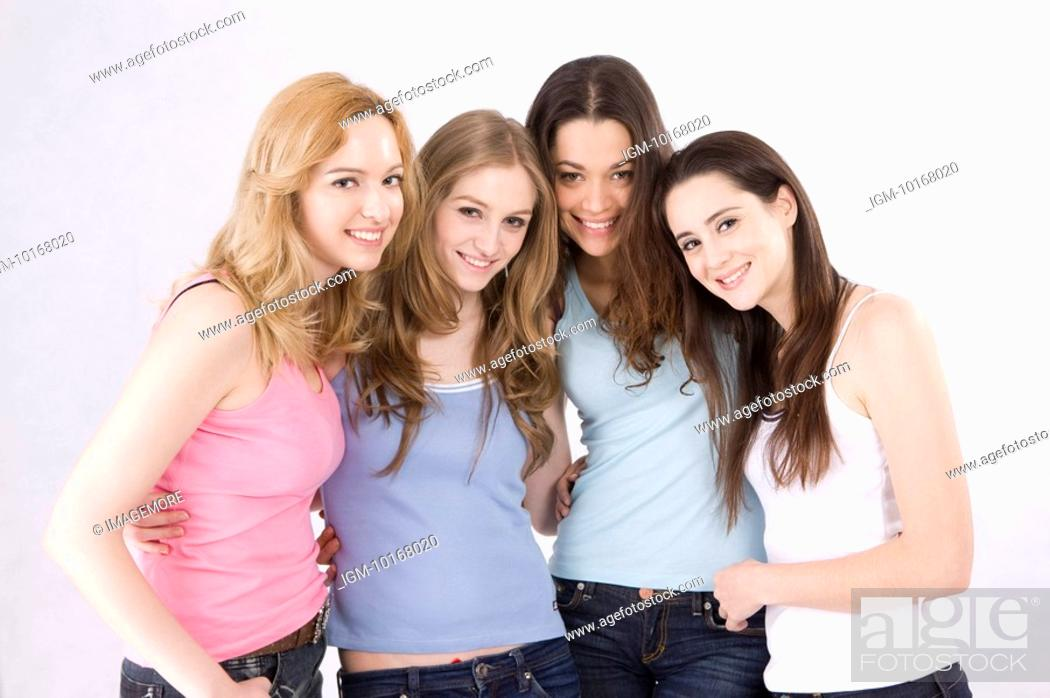 Stock Photo: Portrait of four young women smiling happily.