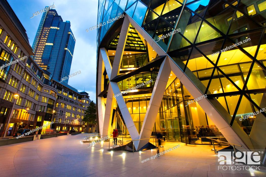 Stock Photo: 30 St Mary Axe or Swiss Re Building nicknamed The Gherkin by architect Norman Foster  London  England  United Kingdom, UK, Europe.