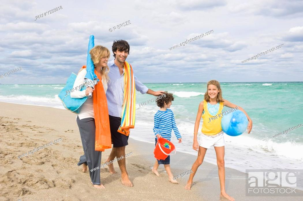 Stock Photo: Family enjoying vacations on the beach.
