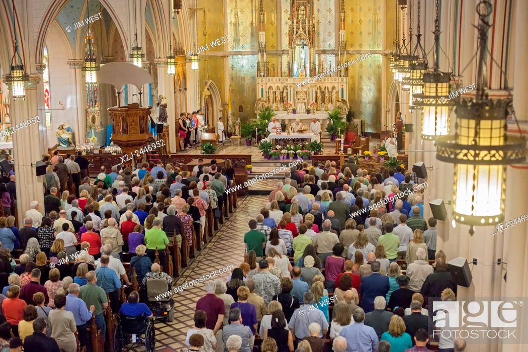 "Stock Photo: Detroit, Michigan - A """"mass mob"""" fills Ste. Anne de Detroit Catholic Church for Sunday morning mass. Organizers try to fill one of Detroit's historic Catholic."