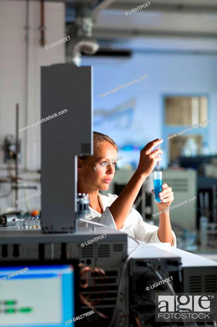 Stock Photo: Portrait of a female researcher doing research in a lab (shallow DOF; color toned image).