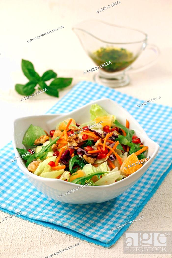 Stock Photo: Salad with pomegranate and tangerines.