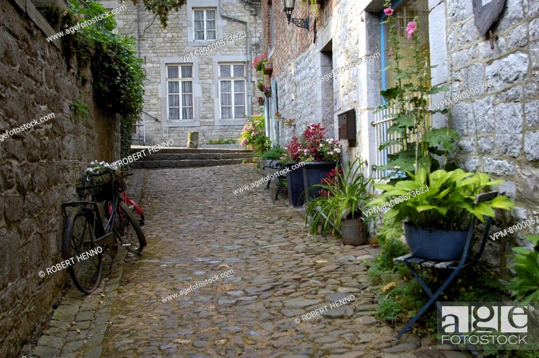 Stock Photo: NARROW COBBLESTONES STREET AND OLD HOUSES IN THE HISTORICAL CENTER OF DURBUYTHE SMALLEST CITY IN THE WORLDARDENNE - BELGIUM.