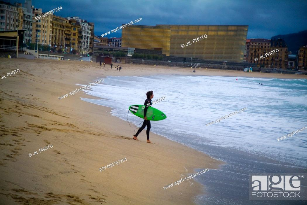 Stock Photo: Surfer with his board, walking towards the sea  Zurriola Beach  Donostia  San Sebastian  Gipuzkoa  Spain.