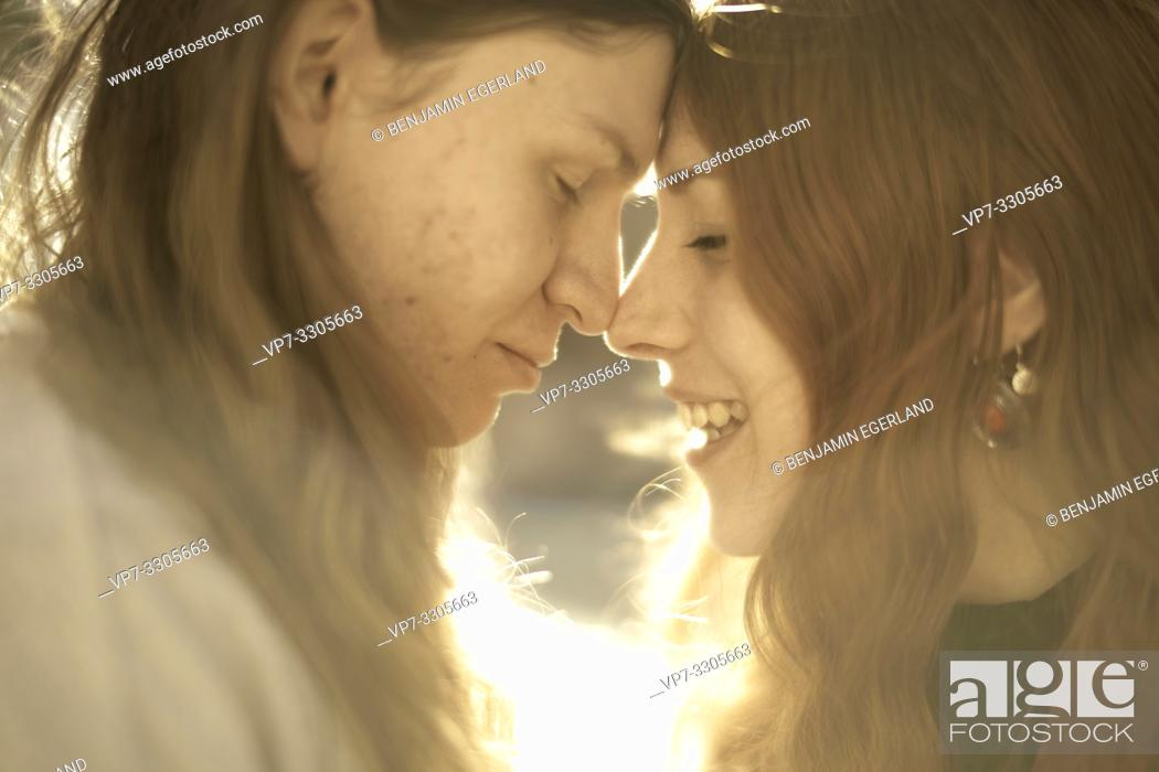 Stock Photo: couple outdoors in sunlight at street in city, in Berlin, Germany.